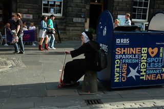 Nun with scooter